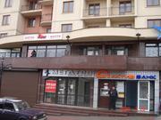 Вывеска магазина RIEKER для торговли обувью.